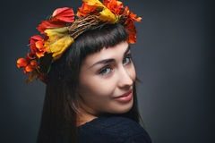 Portrait of a woman with autumn leaves crown Stock Photos