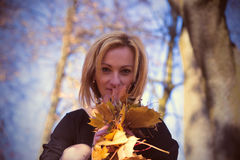 Portrait of a woman with autumn leaves. Photo of portrait of a woman with autumn leaves royalty free stock photography