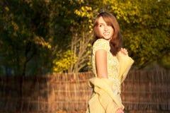 Portrait of Woman on Autumn Nature Background Stock Photo