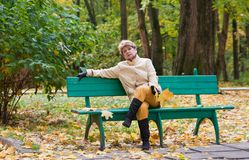 Portrait of woman in autumn park Stock Photo
