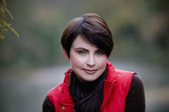 A portrait of a woman in autumn time Royalty Free Stock Image