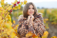 Portrait of woman in autumn vineyard Stock Photo
