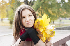 Portrait of the woman in autumn Stock Images