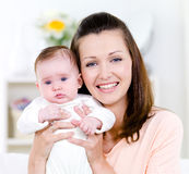 Portrait of woman with baby stock photo