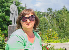 Portrait of a woman on the background of the monument to Lenin Royalty Free Stock Images