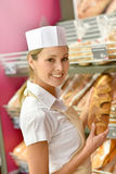 Portrait of woman baker selling bread Royalty Free Stock Photos