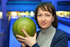 Portrait of woman with ball for bowling Royalty Free Stock Images