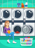 Portrait of woman with basket of clothes in laundry Stock Image