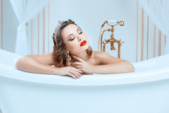 Portrait of a woman in bath. Royalty Free Stock Images