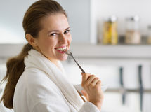 Portrait of woman in bathrobe eating breakfast Royalty Free Stock Photos