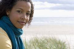 Portrait of woman by beach, close-up Stock Photos