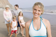 Portrait of woman on beach with family royalty free stock image