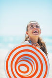 Portrait of woman with beach hat looking up on copy space Royalty Free Stock Image