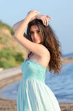 Portrait of woman at the beach wearing coral dress Royalty Free Stock Photo