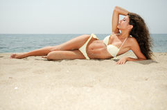 Woman with beautiful body on a tropical beach Royalty Free Stock Photo