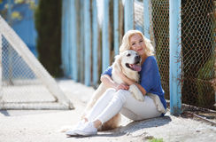 Portrait of a woman with beautiful dog playing outdoors. Royalty Free Stock Images
