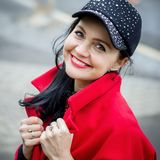 Portrait of a woman. Beautiful fashionable woman in the street. royalty free stock images