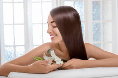 Portrait of woman with beautiful hair in spa salon Royalty Free Stock Image