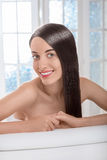 Portrait of woman with beautiful hair in spa salon Stock Image