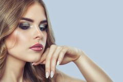 Portrait of a woman with beautiful make-up and manicure. royalty free stock photography
