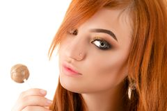 Portrait woman with beautiful makeup and lollipop in hand Royalty Free Stock Image
