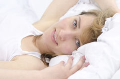 Portrait of a woman in bed Royalty Free Stock Image