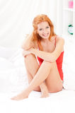 Portrait of woman in bed Stock Photos