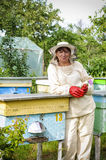Portrait of a woman beekeeper with  flower Stock Photos