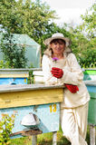 Portrait of a woman beekeeper with flower Stock Images