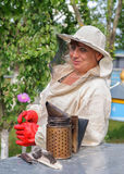 Portrait of a woman beekeeper with flower Royalty Free Stock Photo