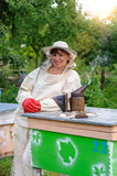 Portrait of a woman beekeeper Stock Photos