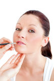 Portrait of a woman being made-up by a pro Stock Photography
