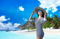Portrait of a woman in the big hat at the tropical beach Stock Photo