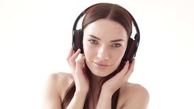 Portrait of a woman with big headphones with music. 1 stock video