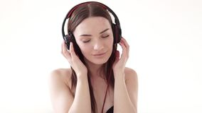 Portrait of a woman with big headphones with music. 1 stock footage