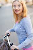 Portrait of woman with bike Stock Photos