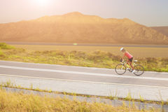 Portrait of a woman on bike near the mountains Royalty Free Stock Image