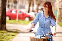Portrait of woman on bike trip in the city. Portrait of happy woman on bike trip in the city stock photo