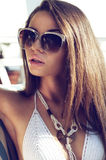 Portrait of woman in bikini. Close up fashion portrait of beautiful tanned woman in swimsuit and sunglasses Royalty Free Stock Photography