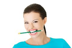 Portrait of a woman biting her pencil Royalty Free Stock Photos