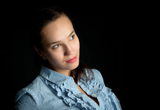 Portrait of a woman on a black background Royalty Free Stock Photo