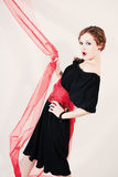 Portrait of woman in black dress with red belt stock images