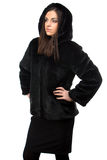Portrait of woman in black fur coat with hood Stock Image