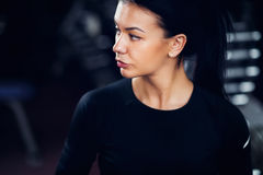 Portrait of woman in black in gym Royalty Free Stock Images