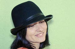 A Portrait Of A Woman With A Black Hat. A Portrait Of A Beautiful Woman With A Black Hat Royalty Free Stock Images