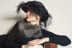 Portrait of a woman with black hat and fur Royalty Free Stock Photography