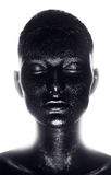 Portrait of woman in black paint in light Royalty Free Stock Image