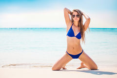 Portrait of woman in black swim posing on tropical beach. Young pretty hot sexy woman on the tropic island in summer near the sea. Young caucasian woman near Royalty Free Stock Photo