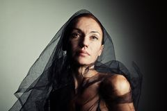 Portrait of a woman in a black veil and underwear. Dramatic style stock photo