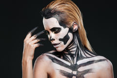 Portrait of woman with blonde hair and halloween skeleton makeup stock photo